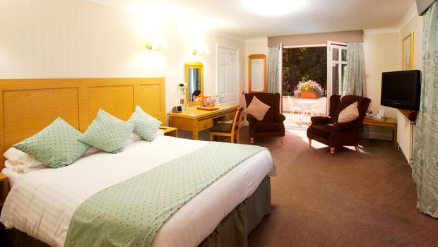 A bedroom at the Appleby Manor Hotel and Garden Spa. PA Photo/Handout.