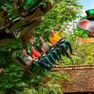 Europa Park: Composite image featuring the 'Arthur' Rollercoaster and a mascot/logo for 'Ireland'.