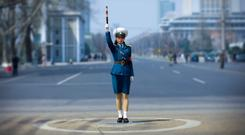 NORTH KOREA: Traffic officer in Pyongyang, where there are no traffic lights. Photo by Eric LAFFORGUE/Gamma-Rapho via Getty Images