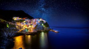 'Stars Over Manarola', one of the five villages of Cinque Terre, Italy, by Declan Keane. 'Set among the rugged cliffs of Liguria, these ancient fishing villages are easily one of the most beautiful places in the world.'