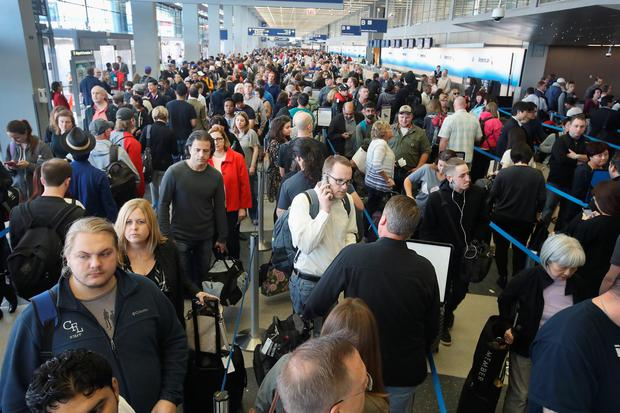 CHICAGO, IL - MAY 16: Passengers at O'Hare International Airport wait in line to be screened at a Transportation Security Administration (TSA) checkpoint on May 16, 2016 in Chicago. Photo by Scott Olson/Getty Images