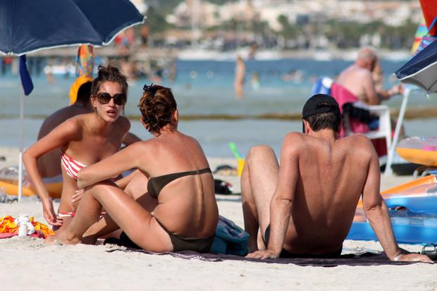 Tourist boom: Sunbathers on Playa de Palma beach in Majorca, Spain.