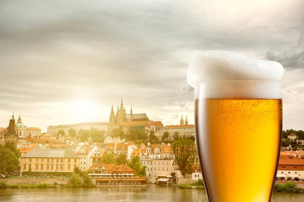 Glass of beer, with Prague (background). Photo: Deposit