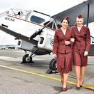 Pictured with the Iolar at Bristol airport are Aer Lingus cabin crew Laura Mc Cabe and Catherine McDonnell, both wearing the very first Aer Lingus uniform worn by cabin crew in 1945. Photo: Dan Regan