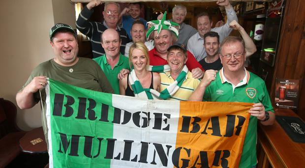 Republic of Ireland supporters Jack Kiernan, Jimmy Corroon, Alisha Burns, Paddy Ward, Tony Molloy, Pat McCoy and Paul Carr from Mullingar, in the Bridge Bar in Mullingar. Jack, Jimmy, Paddy and Paul are travelling to France to support the Republic of Irela