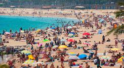 A crowded beach in Barcelona. Photo: Deposit