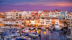 Ciutadella de Menorca marina port at sunset. Ciutadella is a pristine harbour town with beautifully maintained historic buildings