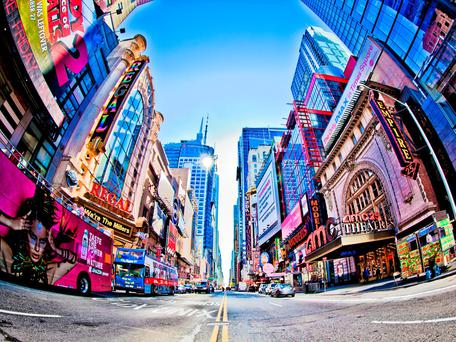 Times Square and 42nd Street is a busy tourist intersection of neon art and commerce and is an iconic street of New York City and America