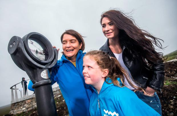 Pictured at the official opening of the Wild Atlantic Way Discovery Point at Derrigimlagh are Orla Carroll, Failte Ireland with Caoimhe Joyce (10) and Kate Shanahan from Creggan. Photo: Pat Moore.