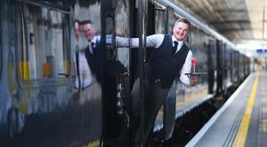 Mark Donegan waits for the first customers to board the Belmond Grand Hibernian at Heuston Station. Photo: Leon Farrell/Photocall Ireland.