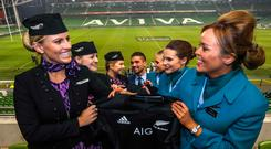 Air New Zealand crew handing over All Blacks jerseys to Aer Lingus crew after Ireland's loss to New Zealand in 2016.
