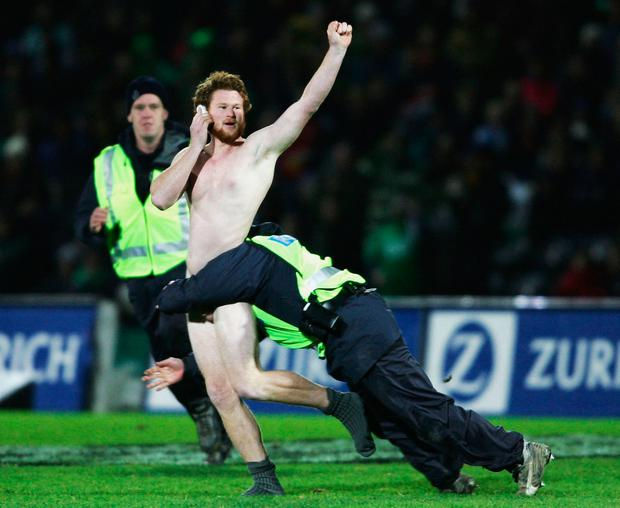 What goes on tour... A streaker is tackled by the police during the match between British and Irish Lions and Manawatu on June 28, 2005. Photo by Shaun Botterill/Getty Images