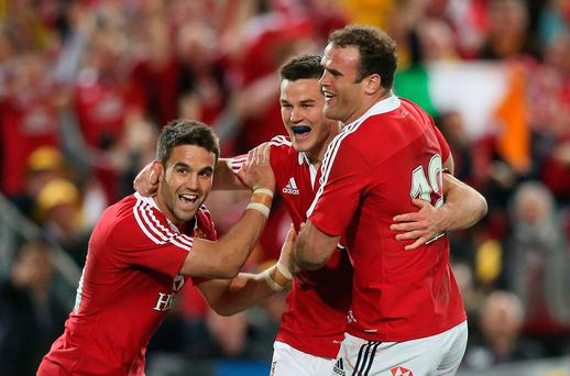 Jonathan Sexton celebrates with teammates Conor Murray and Jamie Roberts during the Lions series win in Australia in 2013. Photo by David Rogers/Getty Images
