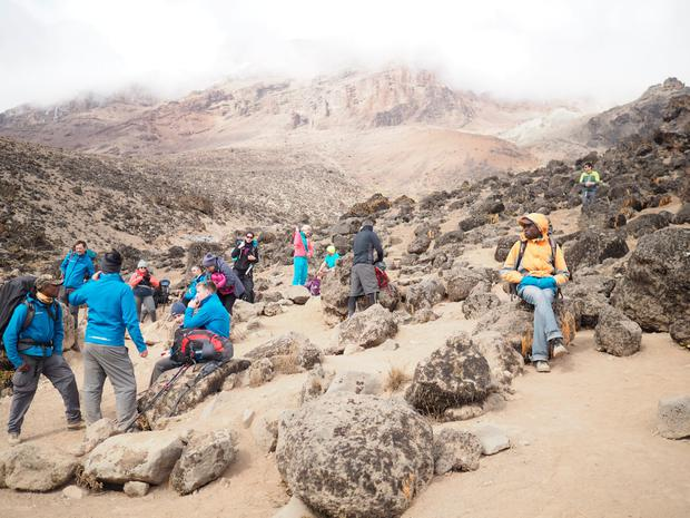 Taking a break on the Kilimanjaro climb. Photo: Kelly Donegan