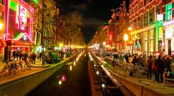 Crowds throng the Red light district (Wallen) in Amsterdam. Photo: Deposit