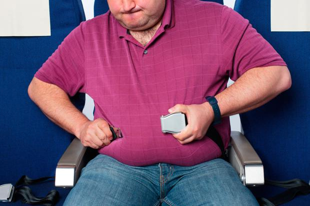 An overweight airline passenger. File photo: Getty