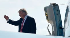 US President Donald Trump salutes before boarding Air Force One on February 6, 2017 in Tampa, Florida. Photo: MANDEL NGAN/AFP/Getty Images