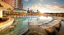 The swim up bar and pool loungers at Hard Rock Hotel Tenerife. PA Photo/Hard Rock Hotels/Roberto Lara.