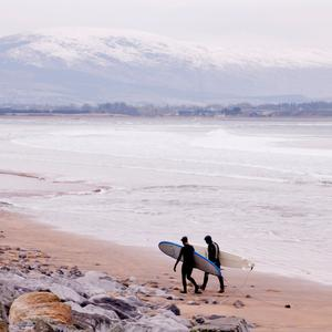 Surfers brave the cold at Strandhill, Co. Sligo