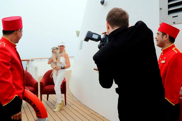 Ivana and Coco having their picture taken on the Queen Mary 2. PA Photo/Karen Bowerman.