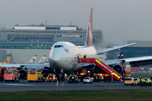 Emergency vehicles attend to Flight VS43, a Virgin Atlantic Boeing 747 at Gatwick airport on December 29, 2014 in London, England. Photo by Jordan Mansfield/Getty Images