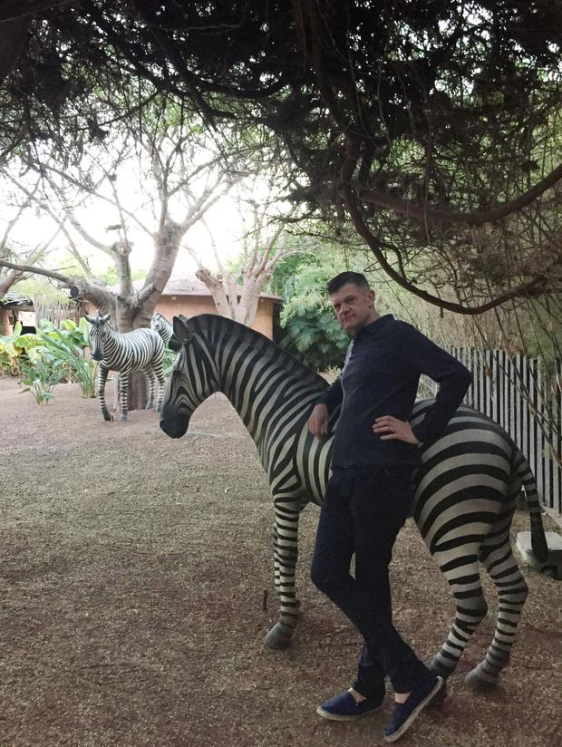 Brendan chills with the resort zebra