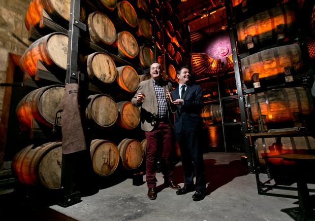 Ray Dempsey, General Manager, Jameson Distillery Bow St with Minister for Public Expenditure and Reform and Paschal Donohoe in the 'Maturation House' at 'Jameson Distillery Bow St.
