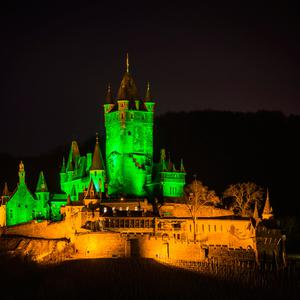 Reichsburg Cochem (Cochem Castle), in Germany, illuminated in green as part of Tourism Ireland's Global Greening initiative, to celebrate the island of Ireland and St Patrick. Pic – Kevin Rühle
