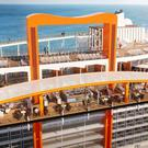 Celebrity Edge - The Magic Carpet spans 16 storeys on the ship. This picture also shows the raised hot-tubs in the pool area and the running track.