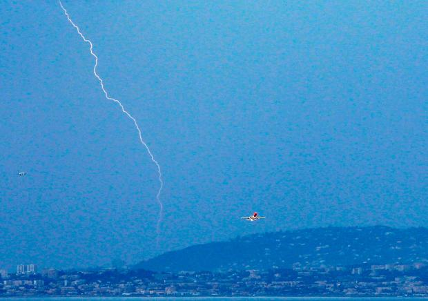 A plane takes off from Nice airport southeastern France, as lightning strikes on June 05, 2011. Photo: VALERY HACHE/AFP/Getty Images