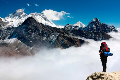 View Everest from Gokyo, featuring a hiker on their way to Everest Base Camp. Photo: Deposit