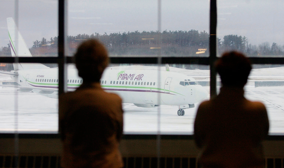 Members of the Maine Troop Greeters watch as a plane full of U.S. Army soldiers taxies to the gate at Bangor Airport in 2006. Photo by Joe Raedle/Getty Images
