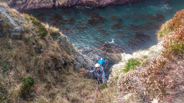 Climbing the Great Pollet Sea Arch, Co Donegal. Photo: Iain Miller, UniqueAscent.ie