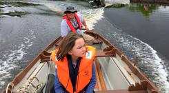 Eoin O'Hagan and his daughter on Lough Derg