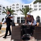 Tunisian employees prepare tables prior to the reopening of the Imperial Merhaba Hotel in Port el-Kantaoui, on the outskirts of Sousse south of the capital Tunis on April 21, 2017. Photo: FETHI BELAID/AFP/Getty Images