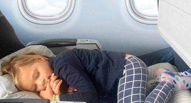 Fly LegsUp can allow young children to sleep in a flat position Credit: Fly LegsUp