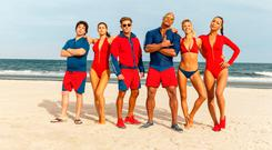Jon Bass plays Ronnie, Alex Daddario plays Summer, Zac Efron plays Matt Brody, Dwayne Johnson plays Mitch Buchannon, Kelly Rohrbach plays CJ Parker, and Ilfenesh Hadera plays Stephanie Holden in Baywatch. PA Photo/Paramount.