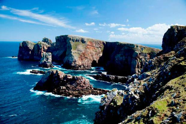 Spectacular cliffs line the promontory of Dún Balair on Tory Island. Photo: Gareth McCormack, from Ireland's Wild Atlantic Way – A Walking Guide by Helen Fairbairn (The Collins Press, 2016)