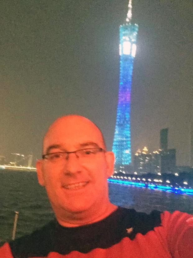Philip on a cruise, in front of Canton Tower