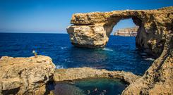 Scuba divers in the Blue Hole on Gozo prepare to descend. The striking Azure Window collapsed earlier this year and can now only be seen by divers. Photo: ©viewingmalta.com