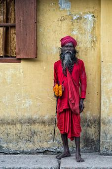 Rashindo Chondo Das, Habiganj, Bangladesh. 'I came across a Sadhu (Hindu holy man),' says Rue Ahmed. As he walked closer to me I gingerly approached him, politely asked him his name in the local language and if he wouldn't mind posing for me. At this point a small crowd gathered around me out of curiosity thinking I was the media, jeering him, exclaiming that he'll be famous around the world after I'd taken his photo! With that I hurriedly snapped three photos of Mr Rashindo Chondo Das as the crowd around me was getting larger by the second, while a couple of hecklers were lending vocal instructions to him on how to pose, which was amusing to say the least! We then parted ways and almost a year to the day I ventured out again to search for him and present him with a copy of the photo; that is another tale & photo moment in itself!' Photo: Rue Ahmed / Rue Photography