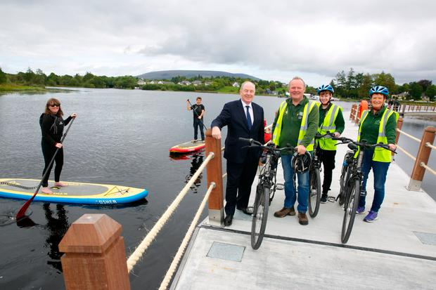 Minister for the Department of Rural and Community Development, Minister Ring TD, opening the new Shannon Blueway Bardswalk.