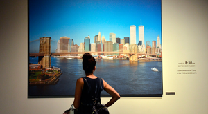 911 Museum, New York. A visitor pauses by a photo of the Manhattan skyline taken around 8.30am on September 11, 2001.