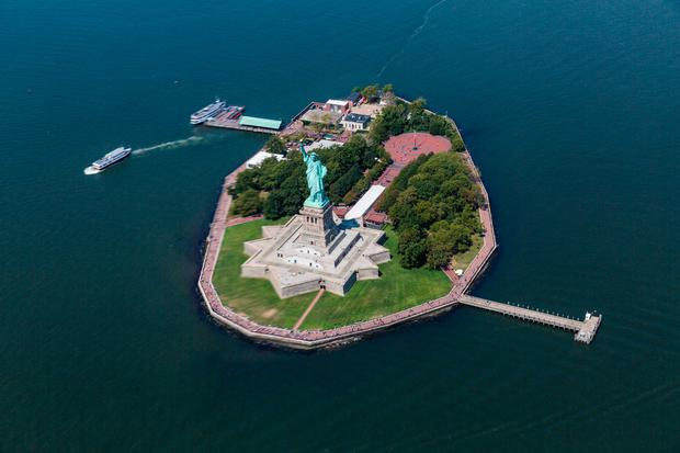 Statue liberty and Ellis Island. Photo: Deposit