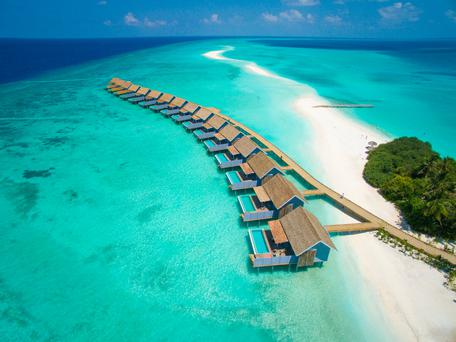 The furthermost tip of Kuramathi Island Resort, in Rasdhoo Atoll in the Maldives, comprises a sandbank that segues seamlessly into the intensely turquoise waters of the balmy Indian Ocean