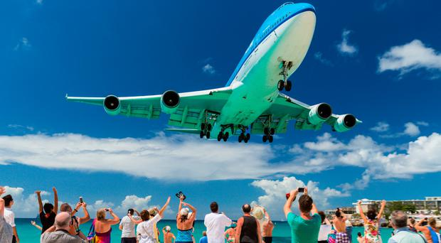 A KLM Boeing 747 on the approach at Saint Maarten. Princess Juliana International is renowned as one of the world's most spectacular landings.