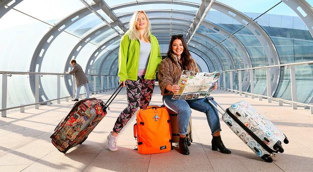 Travel Bloggers Tara Povey and Nadia El Ferdaoussi pictured in Terminal 2 at Dublin Airport. Photo: Frank Mc Grath