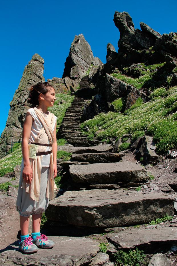 A young girl dressed up as a Star Wars character on Skellig Michael. PA Photo/Nick McAvaney.