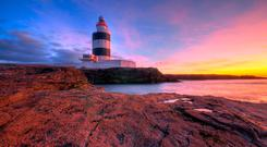 Sunrise at Hook Lighthouse. Photo by Paul Holmes