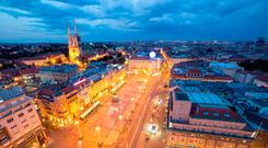 Zagreb capital of Croatia. Panorama by night (Deposit Photos)
